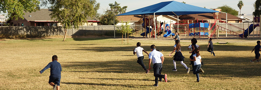 Students running on the playground