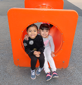 Two happy students on the playground