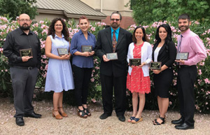 2019 Teachers of the Year holding awards