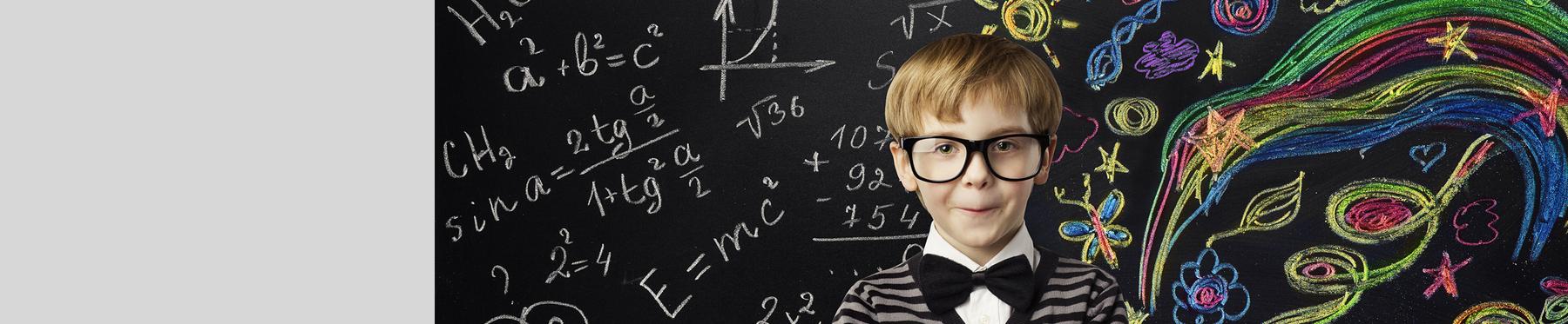 Boy with Math on Chalkboard