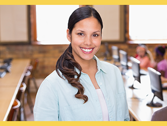 Female teacher smiling with class in background