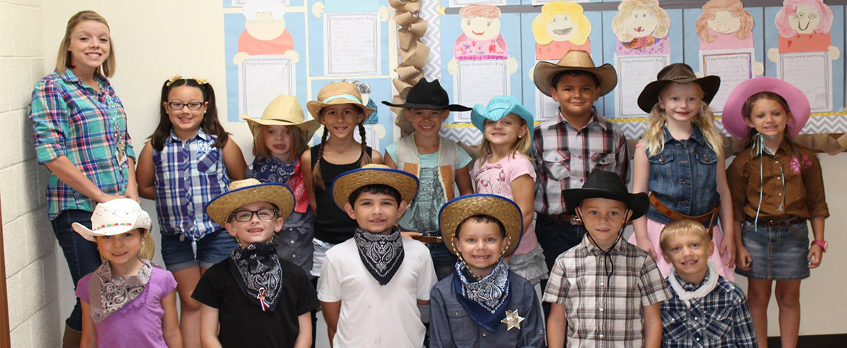 students wearing cowboy hats