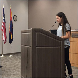 Student speaks at a podium