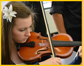Female student plays a violin