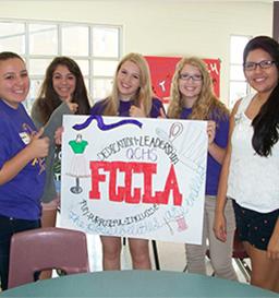 FCCLA members hold up FCCLA sign