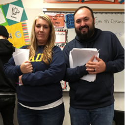 Two smiling teachers pose together