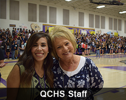 Two smiling QCHS staff members pose together during a pep rally