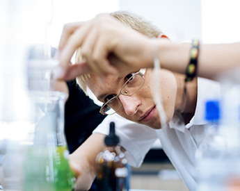 high school student working in the science lab