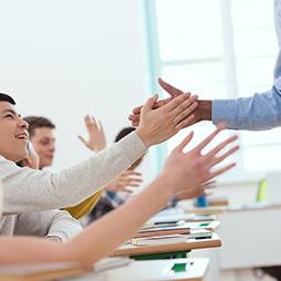 Students giving teacher a high-five