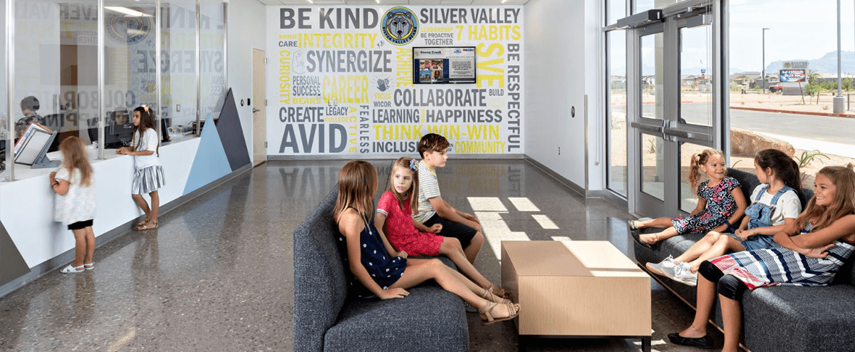 Students sitting together in a school lobby