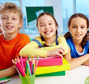three happy students