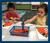 Preschoolers sorting pom poms