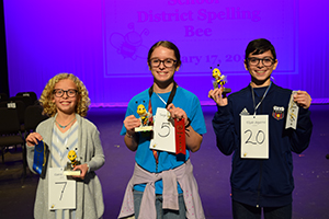 Top three student winners in the spelling bee