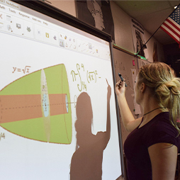 Teacher giving math lecture on SMART board