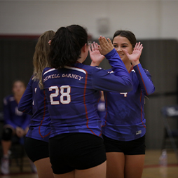 Newell Barney Junior High volleyball players giving High-five