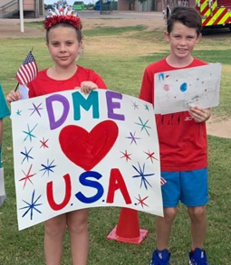Students with American flag and DME USA poster