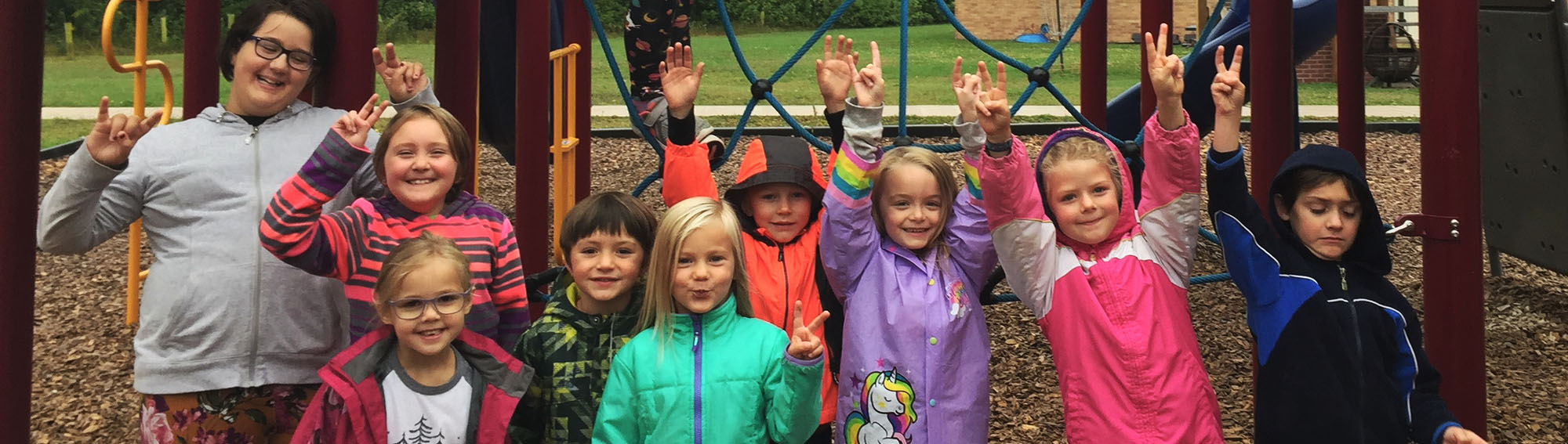 Group of happy Birch Grove students on the playground
