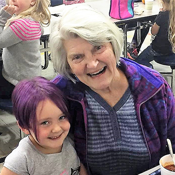 Grandma visiting student with purple hair