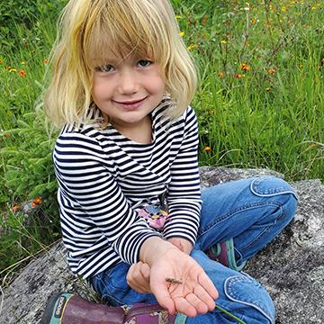 Little girl holding a bug
