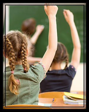 student with raised hand