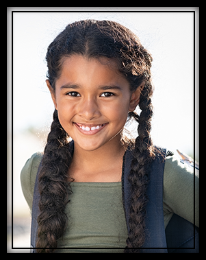 young smiling girl with a backpack