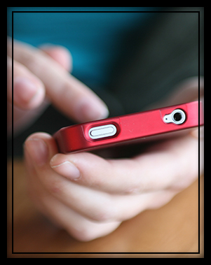 Student using mobile to browse the Internet