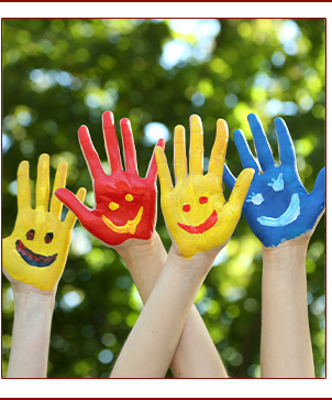 Hands painted with smiley faces