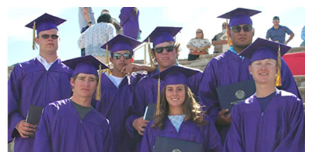 students wearing graduation gowns