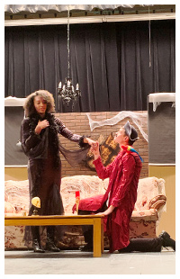 Two students performing in a play