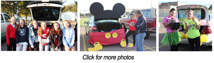 Trunk or treat. Students pose together by a trunk. Mickey Mouse themed trunk. Hawaiian themed trunk.