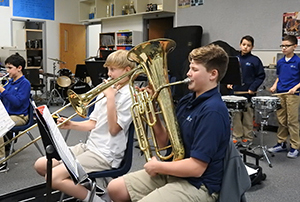 Students playing musical instruments in band
