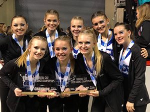 Dance team holding state competition awards
