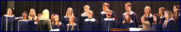 Choir members sing