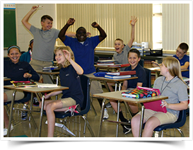 Students cheer in a classroom