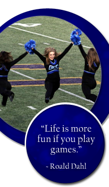 Life is more fun if you play games. Roald Dahl. Cheerleaders dance on a field.