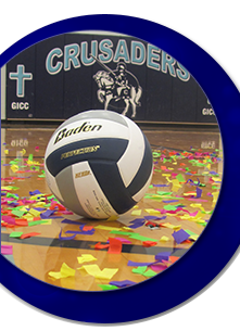 Volleyball on the gym floor surrounded by colorful confetti