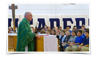 Man speaks to students from behind a podium